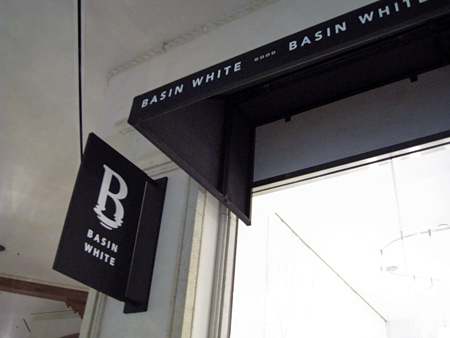 basin-white-sign