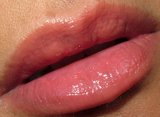 Korres Lip Butter Glaze review swatch of pomegranate on lips