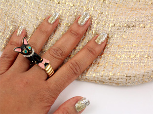 A silver and gold metal ombre manicure