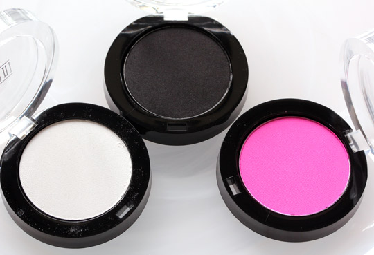 milani powder eyeshadows in white lie, pitch black and shocking pink