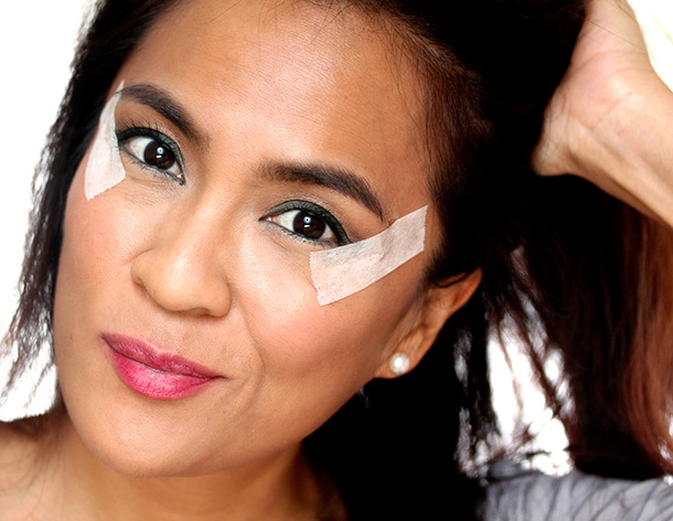 Use tape to create a crisp cat eye edge