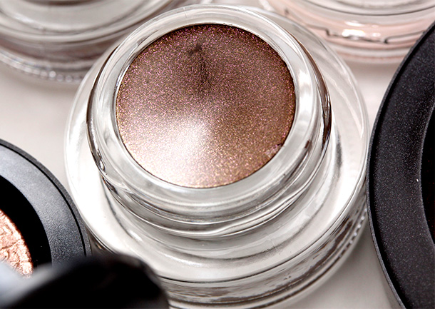 MAC It's Physical Fluidline, a brown with purple pearl and a Pearl finish