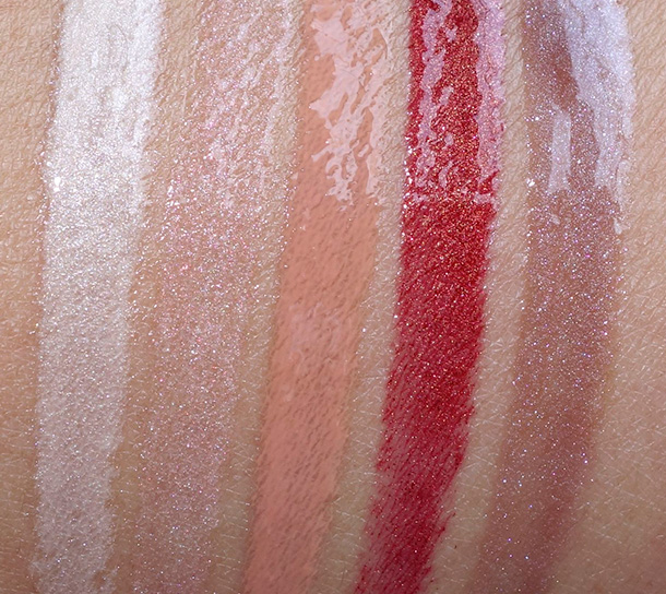 MAC Magnetic Nude Swatches, Lipglasses from the left: A Quiet Roar, Oh My Darling, Overspiced, Hell Bound and Steel Kiss