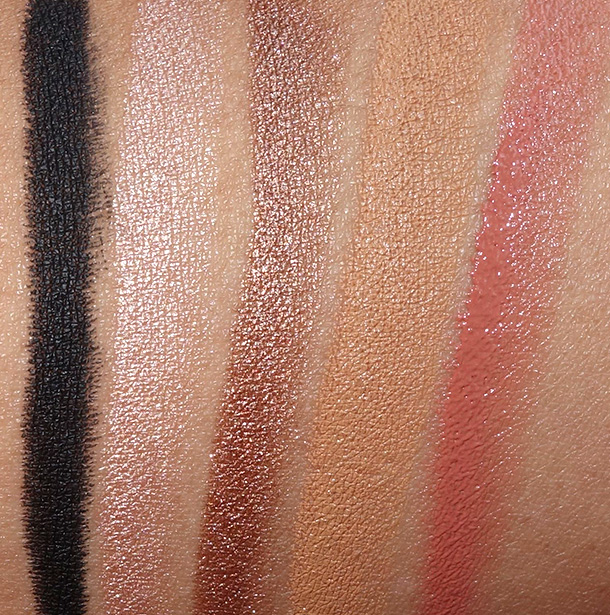NUDESTIX Swatches from the left: Magnetic Eye Color Pencil in Night, Eye Pencil Crayon in Burnish, Eye Pencil Crayon in Stardust, Skin Concealer Pencil in Deep 7, and the Lip and Cheek Pencil in Blush