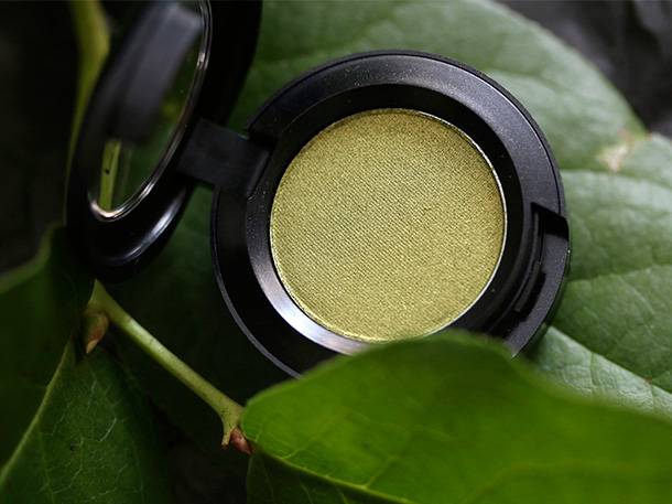 MAC Veluxe Pearl Eye Shadow in Lucky Green, a dark yellow green