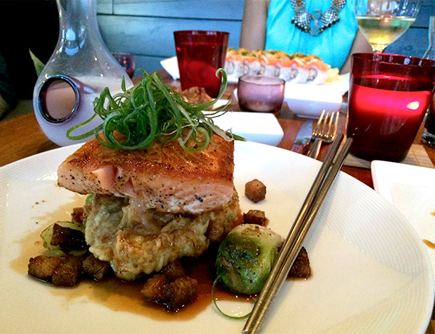 New Zealand King Salmon Entree, a 6oz filet with teriyaki Sauce, tempura brown rice risotto, roasted brussels sprouts with crispy pork belly