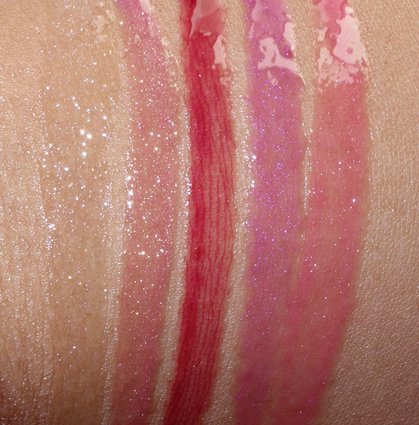 Buxom Lip Gloss Roulette swatches from the left: Full On Lip Polishes in Dominique (glittering ice), Clair (starry plum haze), Isabella (perfectly plum), Jennifer (flirty fuchsia) and Julie (juicy watermelon)