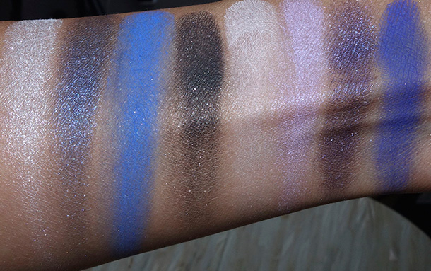 Kat Von D Star Studded Eyeshadow Book swatches from the left: Anti-Star, Estrella, Starflyer, Black Star, Banshee, Violator, Gothica and Fascination Street