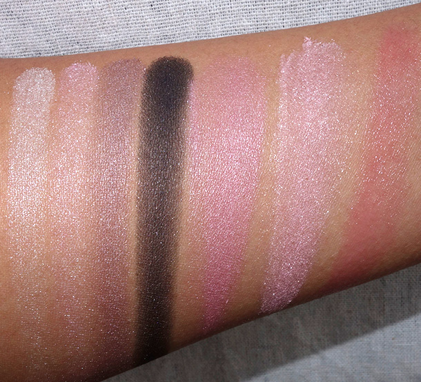 Clinique Nutcracker Suite Act 1 Swatches from the left: beige, pink, taupe and black eyeshadows from the Act I compact; pink blush from the Act I compact; Snowflake Dreams Face Powder, Budding Blossom Chubby Stick Baby Tint