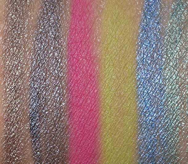 MAC Technakohl Liner swatches from the left: Alpha-Grey, Counterfeit, Funfare, Sourpuss, Skyscape and Vent