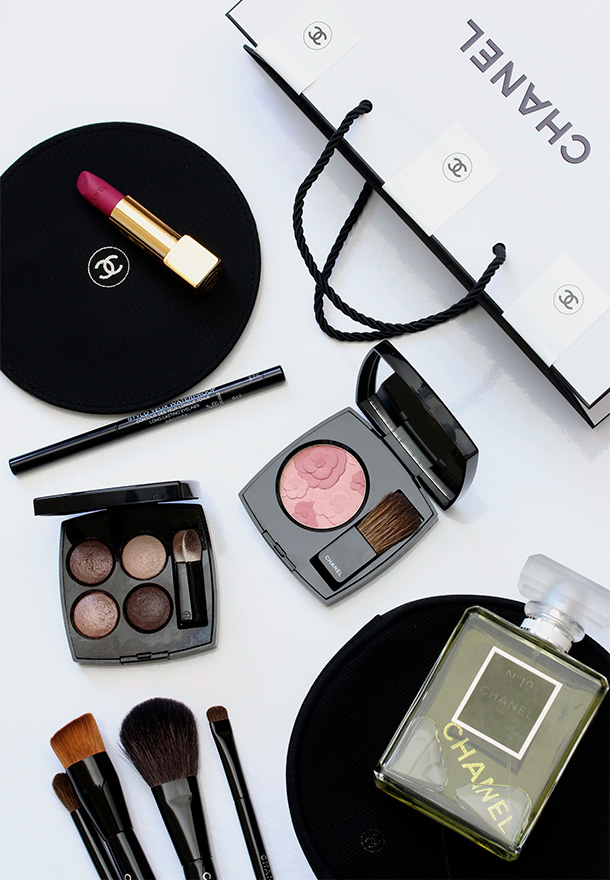 Clockwise from the upper left: Chanel Rouge Allure Velvet in La Romanesque, Stylo Yeux Waterproof Long-Lasting Eyeliner in Ardoise, Jardin de Chanel Blush Camerlia Rose, Chanel No. 19 Poudre and Les 4 Ombres Mluti-Effect Quara Eyeshadow in in Tisse Rivoli