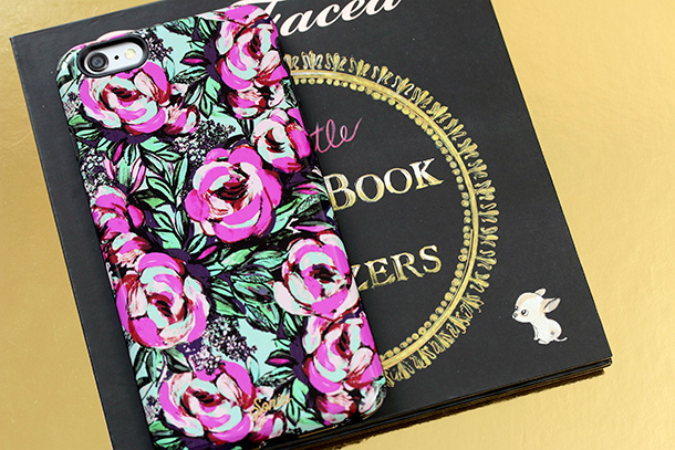 The Little Black Book of Bronzers Bronzer Collection with an iPhone 6 plus for scale