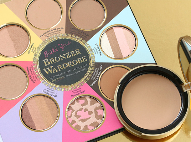 The Little Black Book of Bronzers Bronzer Collection with a full-size Too Faced Bronzer pan for scale