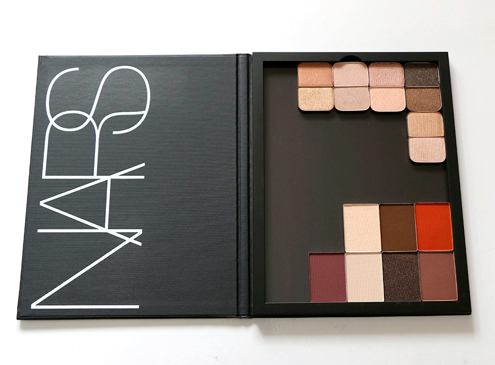 Side view of the large NARS Pro Palette with some eyeshadow duos and singles