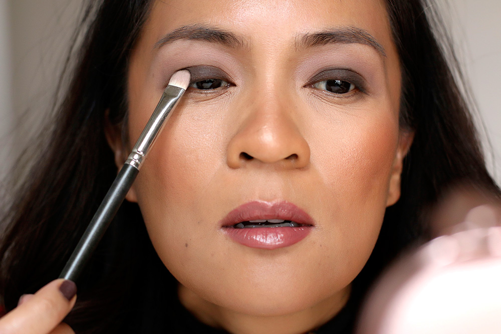 5 apply dark brown to lids'