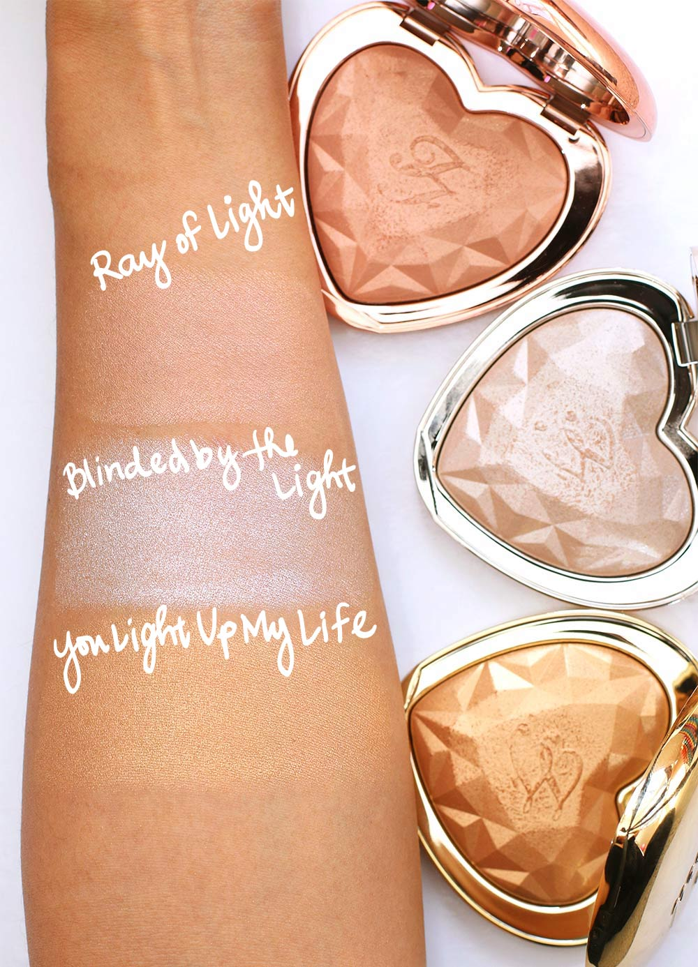 too faced love light prismatic highlighter swatches