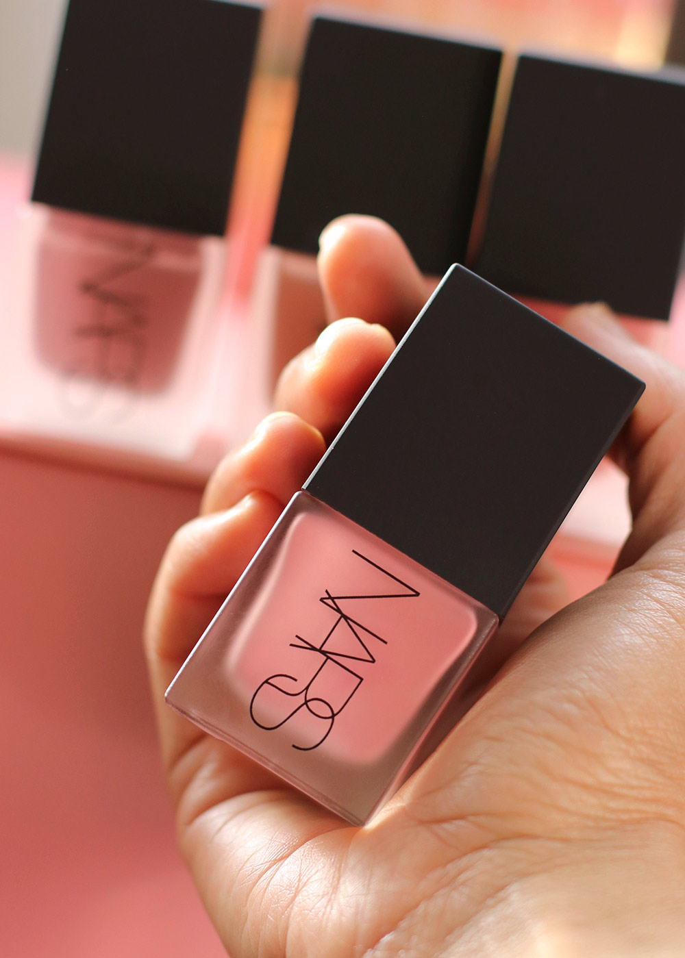 nars liquid blushes in hand