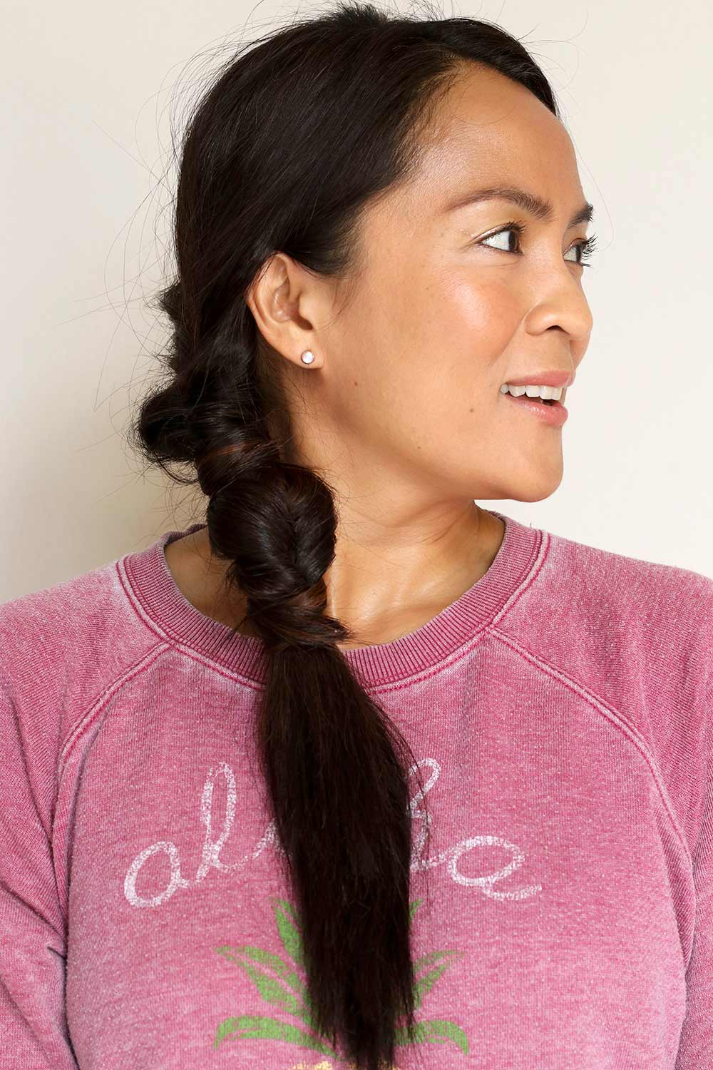 low double side roll ponytail front