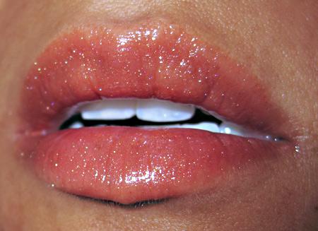 mac naked honey swatches buzz lipglass on lips