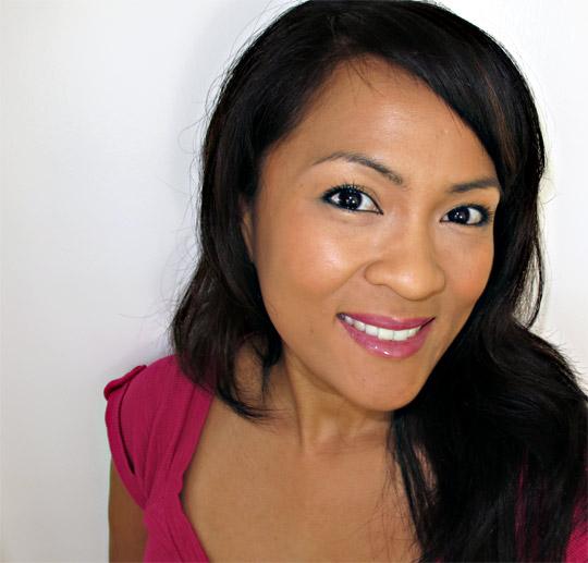 karen from makeup and beauty blog wearing lorac shocking twist tie dye gloss