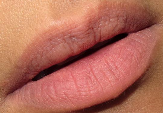 karen of makeup and beauty blog wearing the becca beach tint in grapefruit on lips