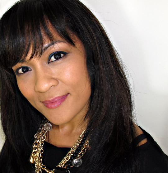 karen of makeup and beauty blog wearing nars easy lover lipgloss from the follow the boys holiday 2010 set