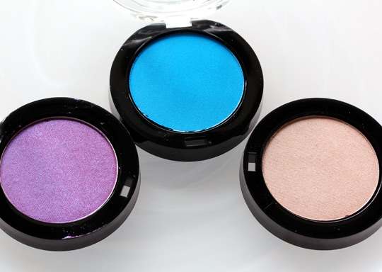 milani powder eyeshadows in purple shock, olympian blue and pearl