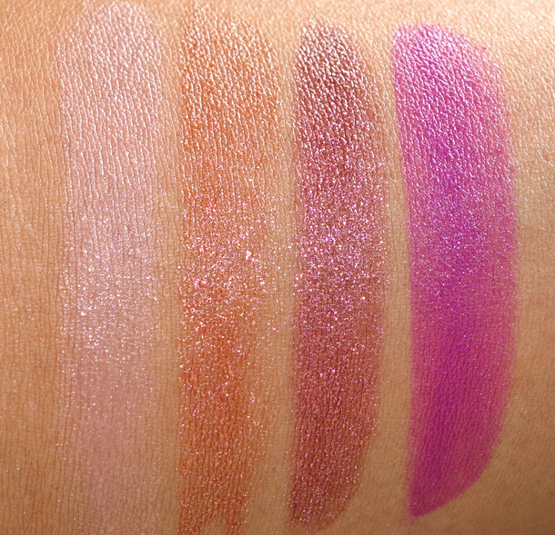 MAC Temperature Rising Swatches from the left: Altered Beige (a creamy yellowish beige with a Lustre finish), Sheer Seduction (a super dazzle bronze with a Dazzle finish), Caliente (a super dazzle violet with a Dazzle finish) and Feel My Pulse (a vivid magenta violet with a Cremesheen finish)