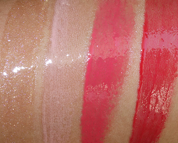 MAC Nocturnals Mini Gloss Kit in Coral Swatches from the left: Dazzleglass in Moth to Flame (a sheer neutral beige with a violet pearl), Cremesheen Glass in On the Scene (a pink with pink and white pearl), Cremsheen glass in Star Quality (a bright orange coral) and Cremesheen Glass in Night Is Young (a bright red cream)