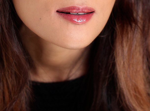 Jouer Riviera Lip Gloss, a sheer, shimmery true red that flatters cool skin tones