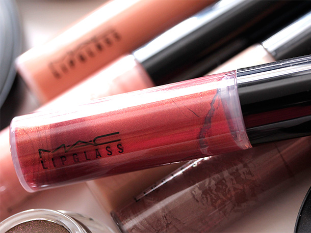 MAC Hell Bound Lipglass, a brick red with golden pearl