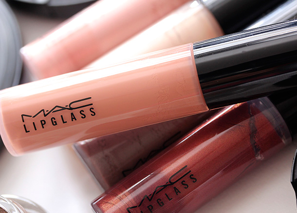 MAC Overspiced Lipglass, a dirty muted coral