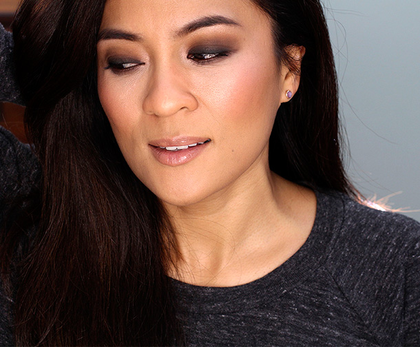 Brown smokey eyes with nude peachy coral cheeks and lips