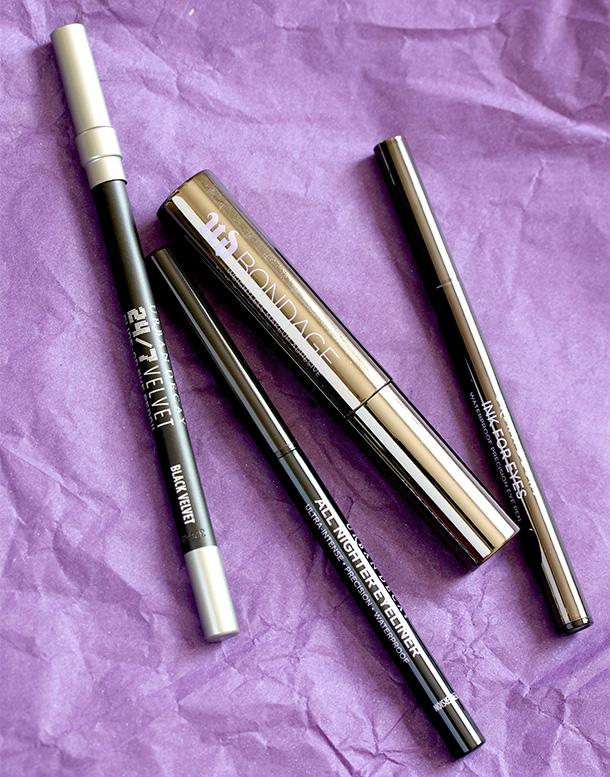 From the left: 24/7 Velvet Glide-On Eye Pencil in Black Velvet, All Nighter Eyeliner in Perversion, Bondage Weightless Makeup Adhesive and Ink for Eyes in Perversion