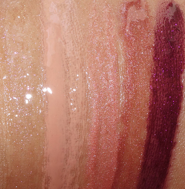 MAC Alluring Aquatic Lipglass swatches from the left: Clear Water, Peachstock, Water Deities, Seducing Sound and Modern Lure