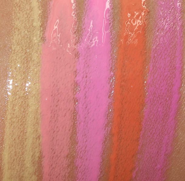 MAC Playland Lipglass Swatches from the left: Bright Side, Lots of Laughs, Carousel, Live It Up and Pure Silliness
