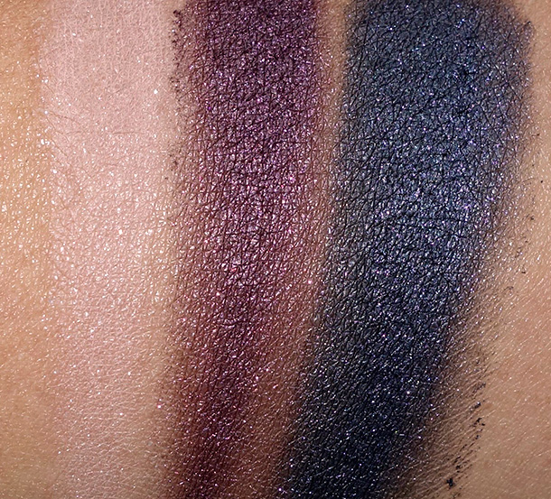 Too Faced Rock N Roll Palette Swatches from the left: New Wave (a satiny, peachy pink with silver glitter), Pop (a shimmery deep purple with hot pink glitter) and Heavy Metal (a shimmery navy blue with purple glitter)