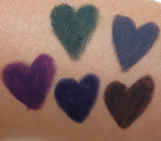 Urban Decay 247 Velvet Glide On Eye Pencil Swatches clockwise from the purple shade in the lower left: Plushie, Cult, Lure, Lush and Minx