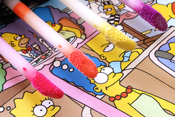 MAC Simpsons Lipglasses from the let: Red Blazer, Grand Pumpkin, Nacho Cheese Explosion and Itchy & Scratchy & Sexy