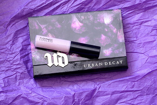 Urban Decay Shadow Box with a MAC Lipglass for scale