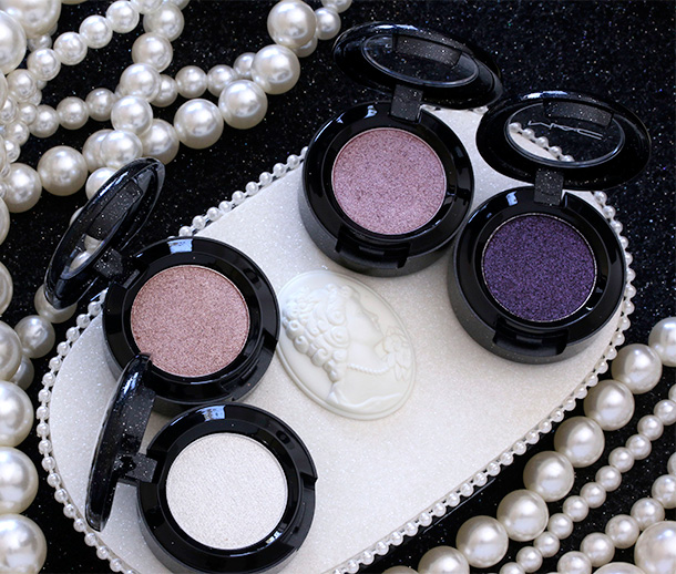 MAC Heirloom Mix Pressed Pigments clockwise from the lower left: Regal Affair, Nostalgic, Noble Descent and Victorian Plum
