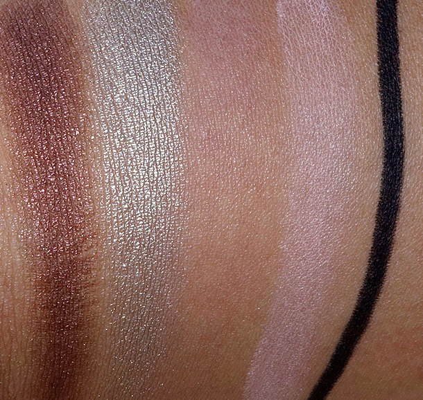 Buxom Dollys High Roller Collection swatches from the left: Eyeshadows in Chocolate Diamonds, Cha-Ching, Strip Poker and Royal Flush; Hold the Liner Waterproof Eyeliner in Call Me