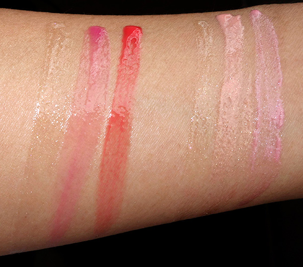 Jouer Bisou Bisou glosses on the left and French Kiss glosses on the right