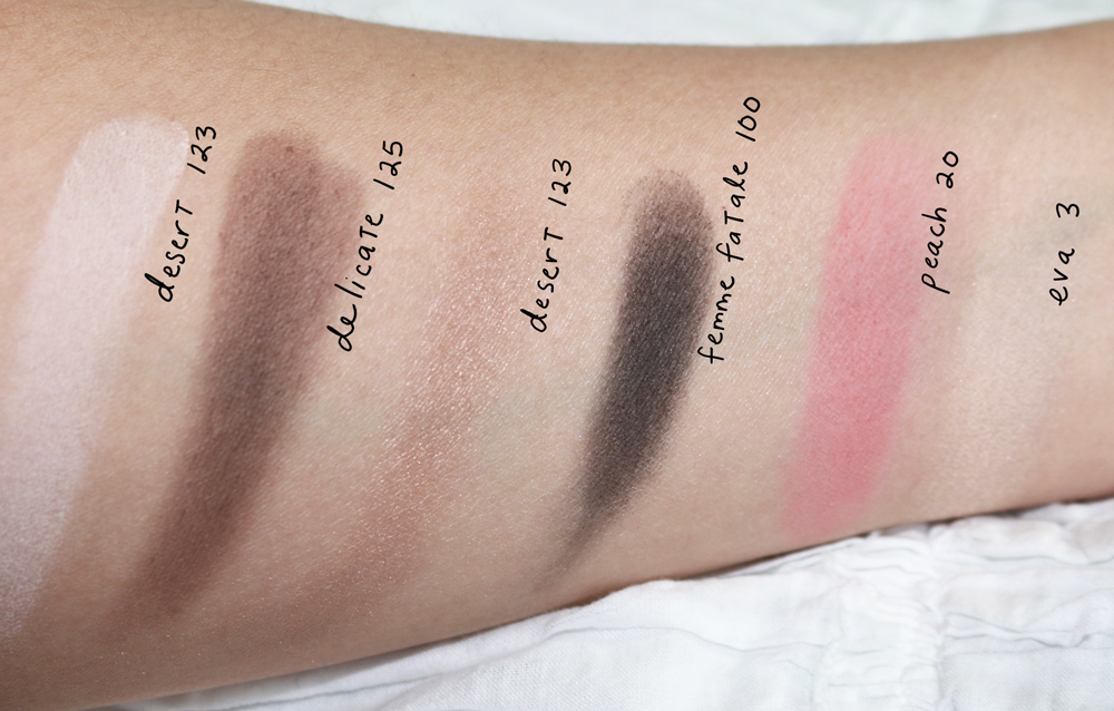 "Swatches of ""The Eyeshadow,"" ""The Blush,"" and ""The Illuminator"""