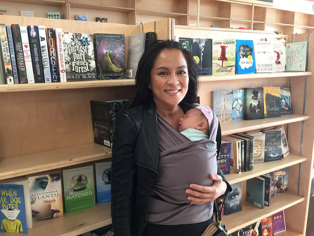 Checking out Mom's favorite area -- the YA books!