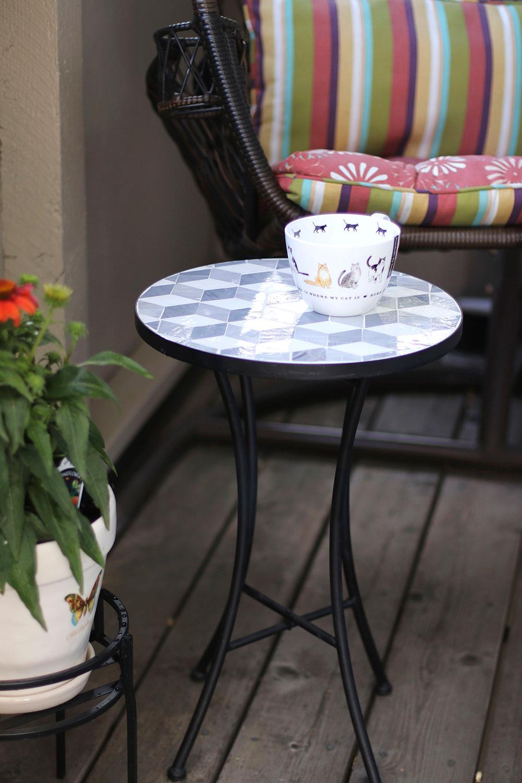 portobello cat cup on mosaic table
