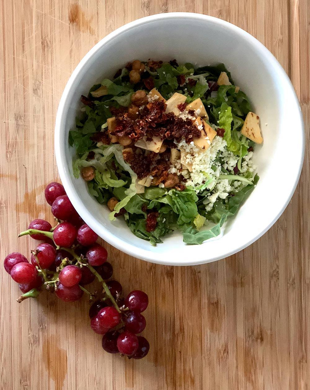trader joes hacks salad in bowl with grapes
