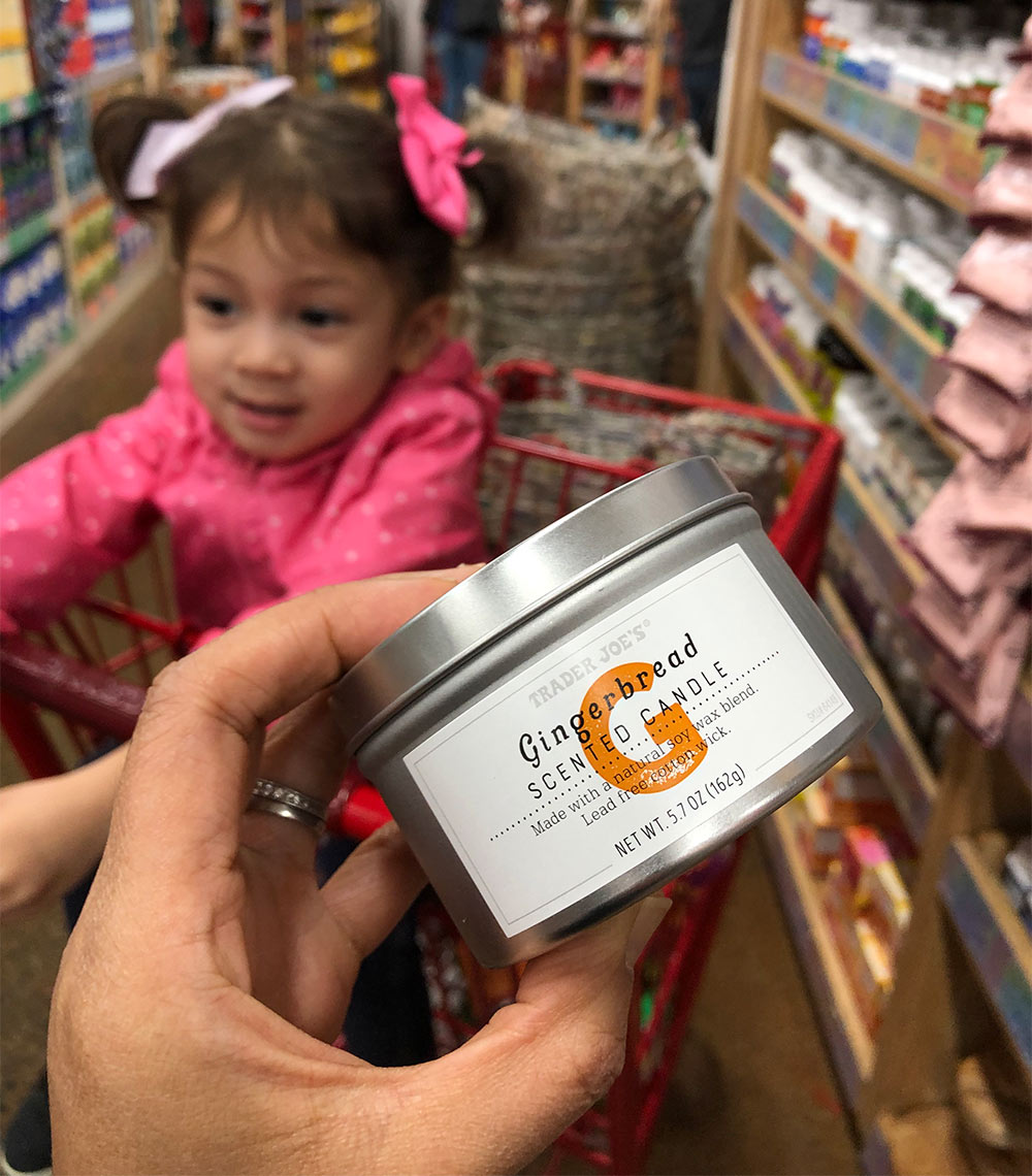 trader joes gingerbread scented candle in hand