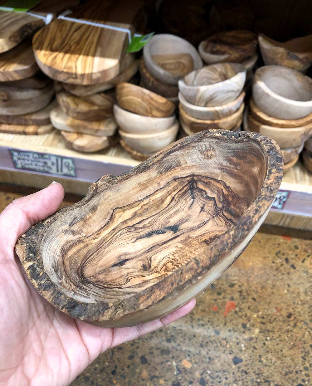 trader joes olivewood bowls in hand
